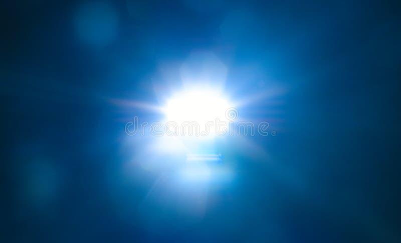 Blue light flare special effect  on black background , concert lighting.  stock image