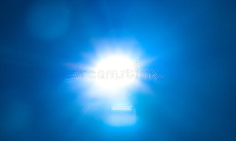 Blue light flare special effect  on black background , concert lighting.  stock images