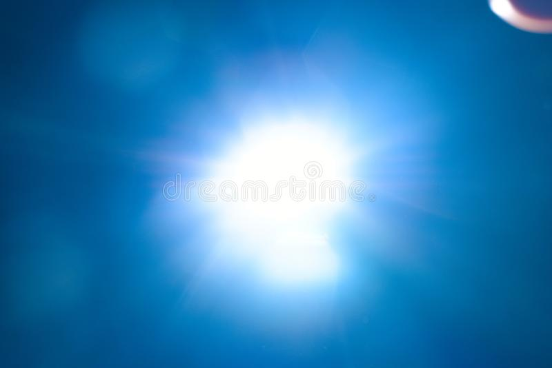 Blue light flare special effect  on black background , concert lighting.  royalty free stock images