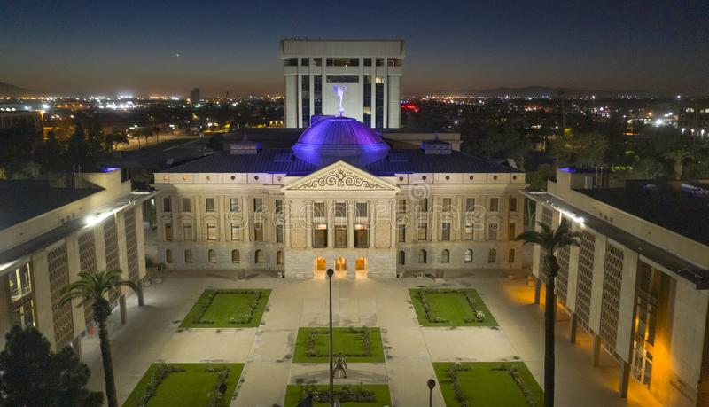 Blue light illuminates the roof of the Arizona Capitol building in Phoenix USA. Arizona Statehouse Aerial View State Capitol Phoenix Downtown stock photos