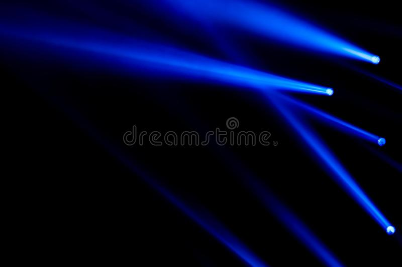 Blue light laser sportlight for concert entertainment and clubing effect lighting effect background. Blue light rays laser sportlight for concert entertainment stock photo