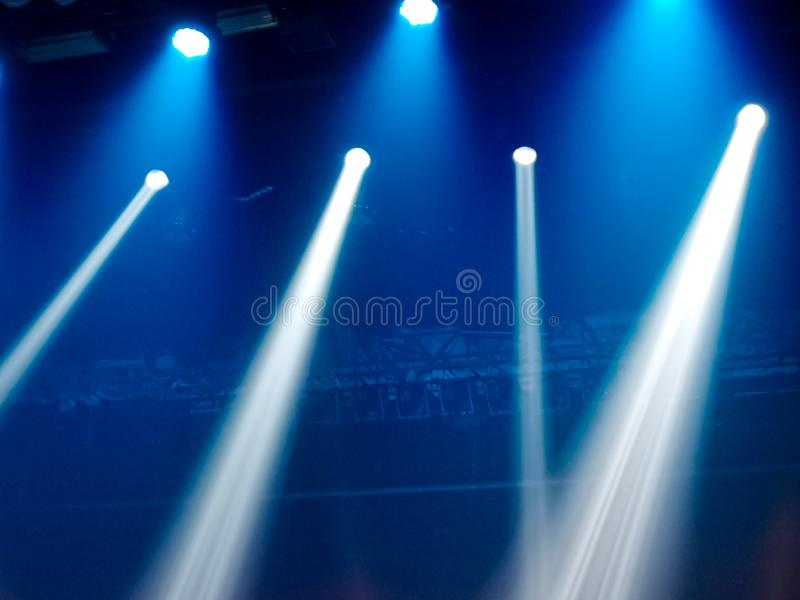 Blue light on the stage at a concert as a background royalty free stock photography