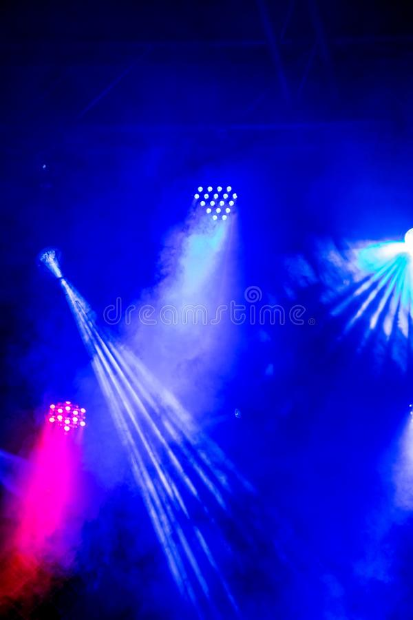 Rock concert theme with LED lights and rays on stage stock photography