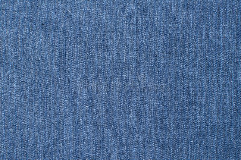 Blue linen fabric closeup. Blue linen fabric texture surface closeup as textile background stock photo