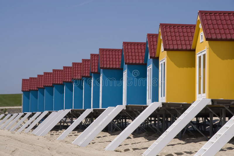Blue little Beach-houses. Blue little beachhouses on a row royalty free stock image