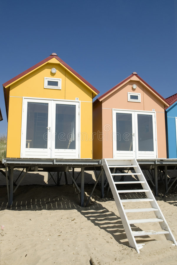 Blue little Beach-houses. Blue little beachhouses on a row royalty free stock photography