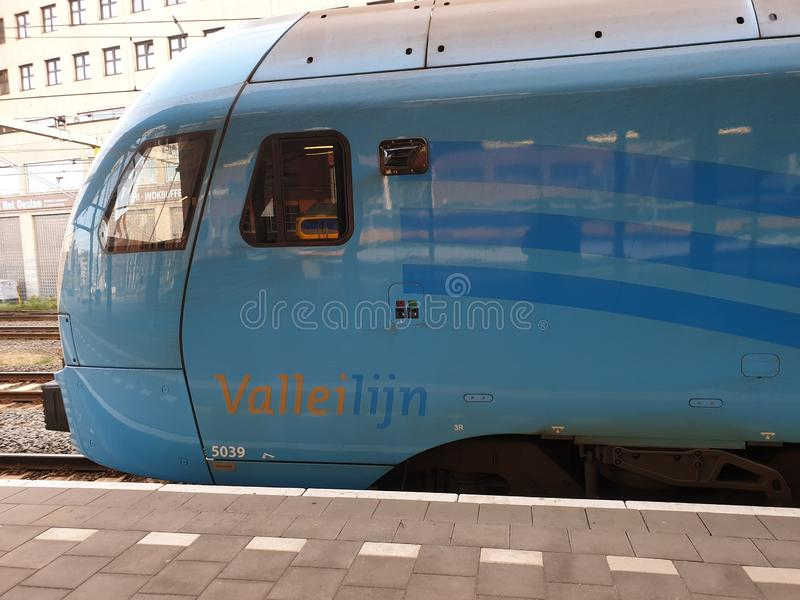 Blue local commuter train type Flirt of the Valleilijn runned by Connexxion at station Amersfoort stock photos