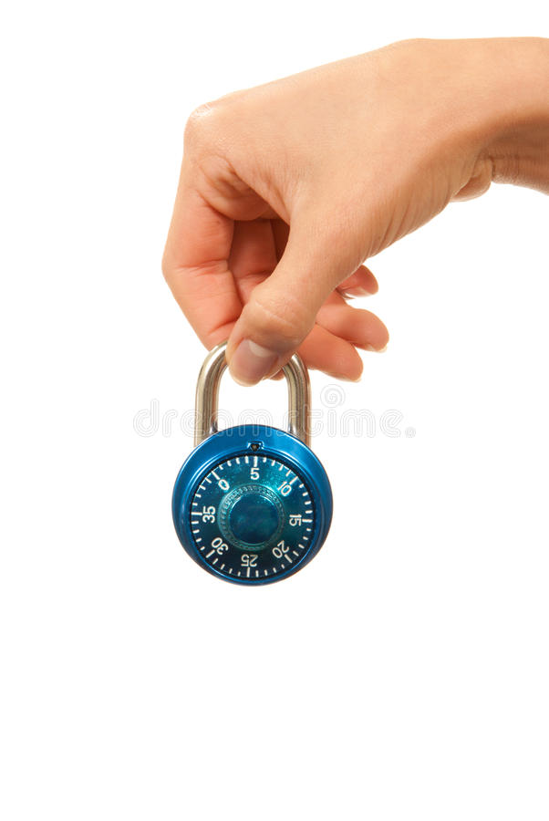 Blue locked Master Combination Dial lock in hand. For security isolated on a white background royalty free stock image