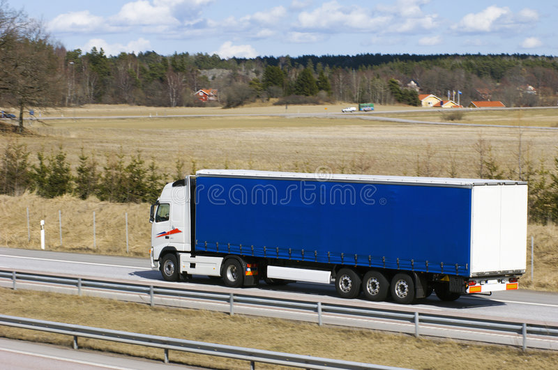 Blue lorry in countryside stock photos