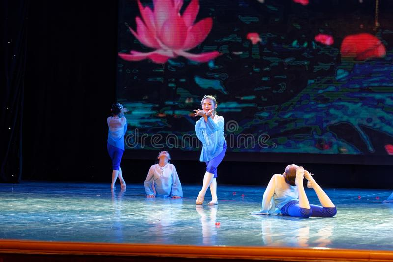 Blue lotus- Beijing Dance Academy grading test outstanding children`s dance teaching achievement exhibition Jiangxi. Sponsored by the Beijing Dance Academy stock photo