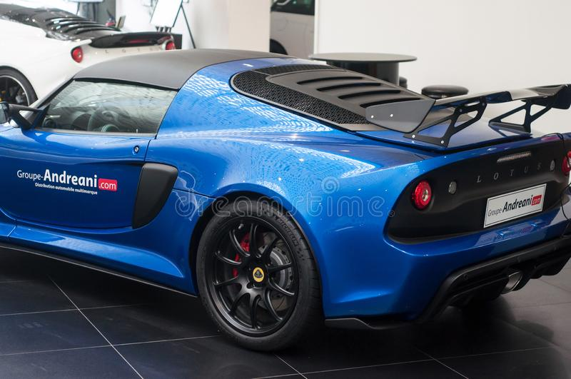 Blue Lotus exige rear view  at retailer showroom. Mulhouse - France - 9 October 2019 - Closeup of blue Lotus exige rear view  at retailer showroom royalty free stock photo
