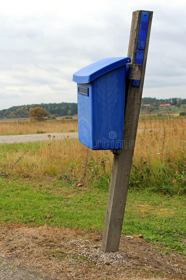 Blue Mailbox By Autumn Road Stock Photography