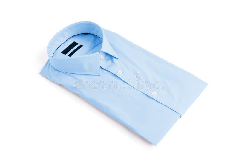 Blue man shirt on white background. New and folded stock images