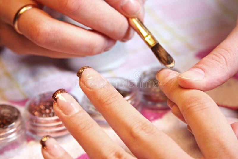 Blue manicure royalty free stock image