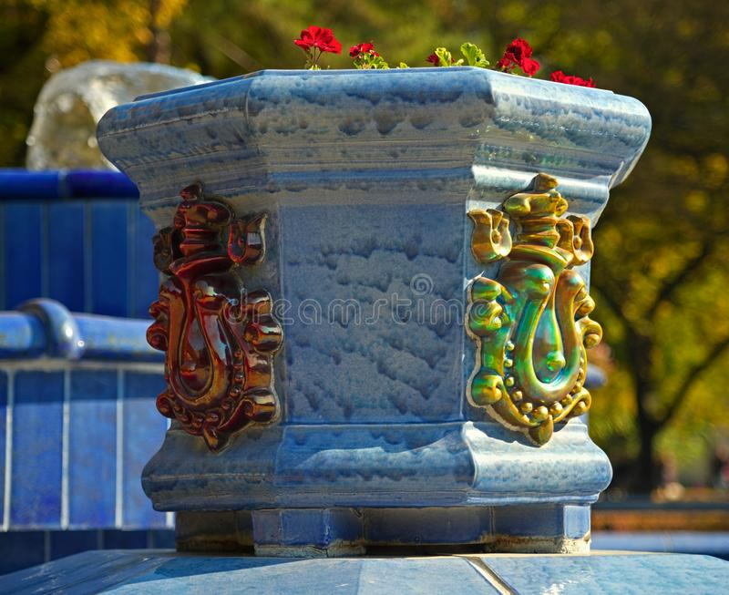 Blue marble flowerpot with decorations and flowers.  royalty free stock images