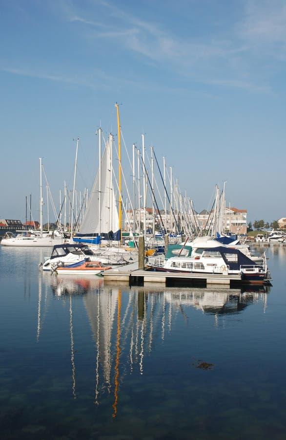 Blue marina boats reflected stock image