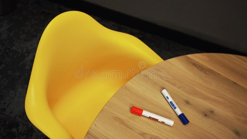 Blue Marker on Brown Wooden Table stock images