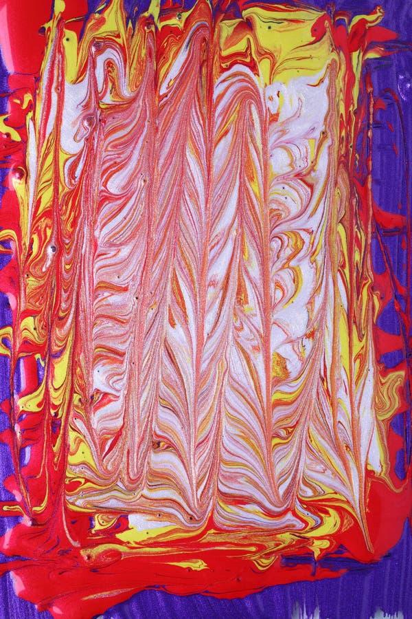 blue marmorerad röd vit yellow arkivfoto