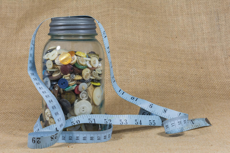 Download Blue Mason Jar Full Of Buttons Stock Photo - Image: 50516097