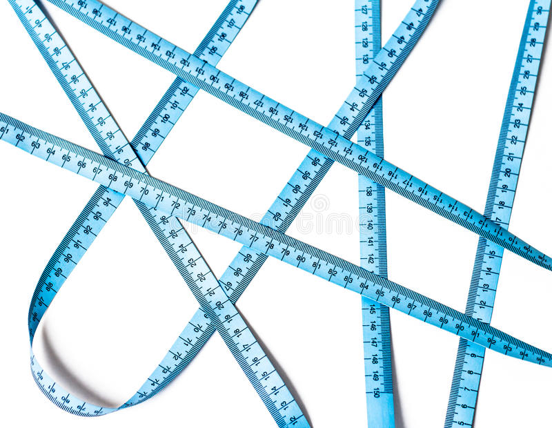 Blue measuring tape crossings isolated royalty free stock image