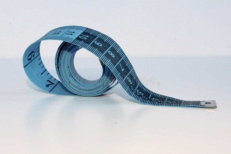 Blue measuring tape stock photography