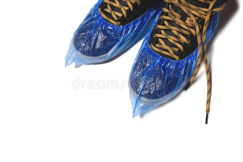 Blue medical disposable clean Shoe covers dress over shoes, men`s leather shoes in clean Shoe covers, Shoe covers, cleanliness an stock photos