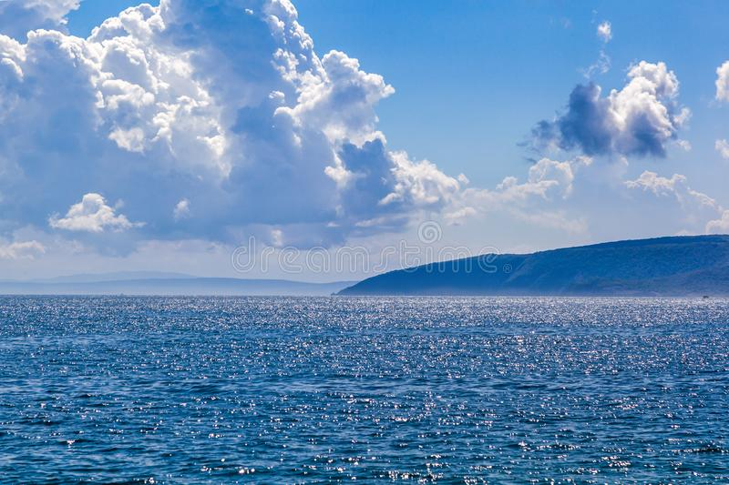 Blue Mediterranean sea with cloudy sky royalty free stock photography