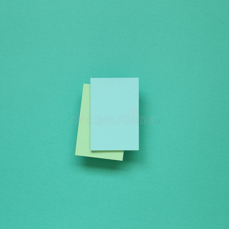 Blue memo paper, sticky notes on mint green background. Top view, copy space royalty free stock image