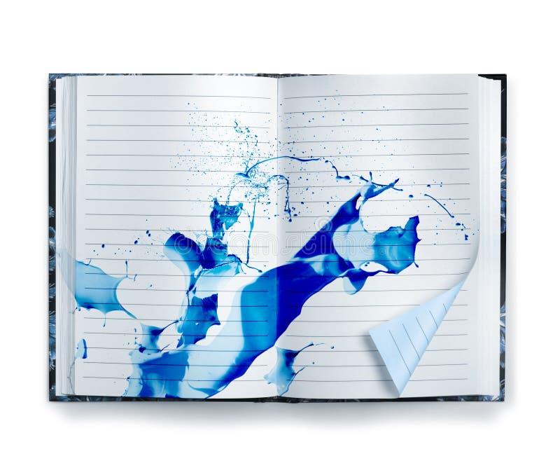 Blue memories notebook ink splash stock photo