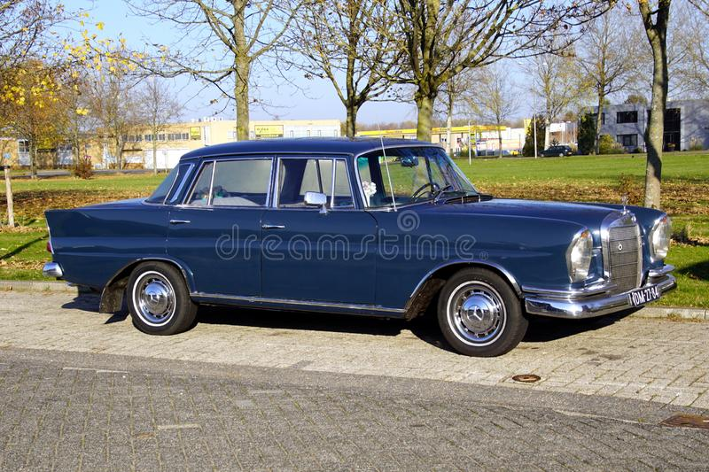 Blue Mercedes-Benz 220. Almere, The Netherlands - November 17, 2018: Mercedes-Benz 220 parked on a public parking lot. Nobody in the vehicle stock photos