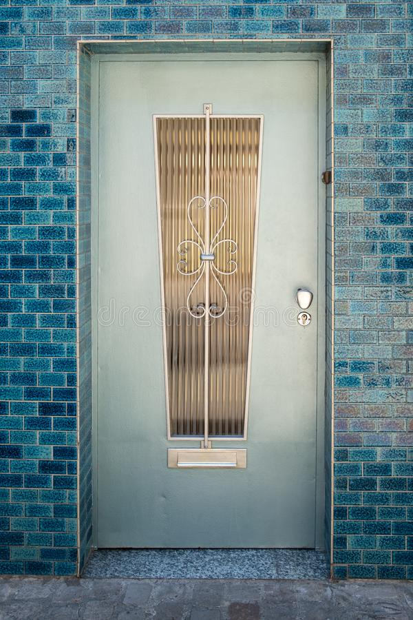 Blue metal door with window royalty free stock photography
