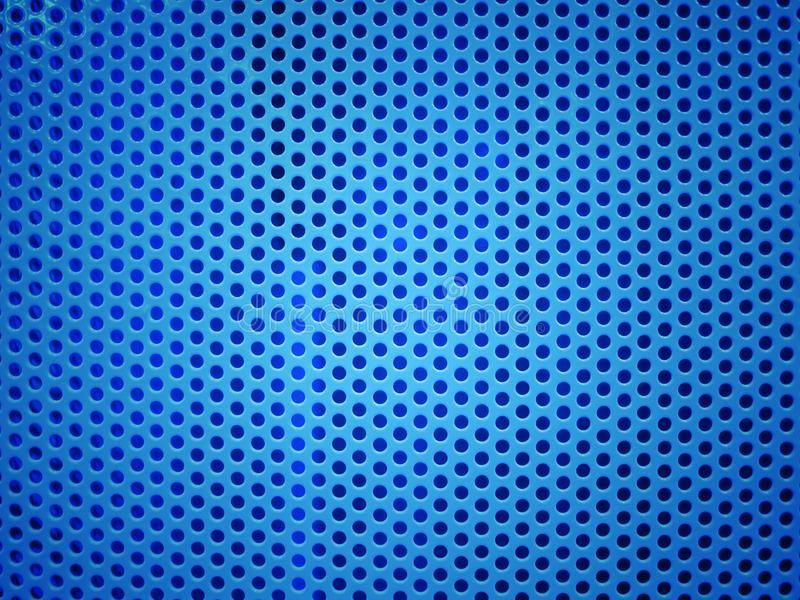 Blue metal hole or perforated grid background royalty free stock image