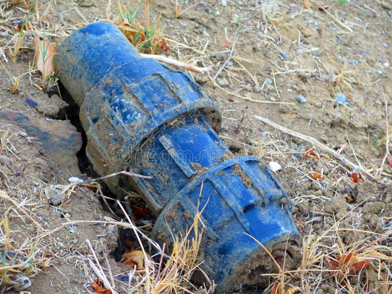 Blue metal object. Unidentified blue metal object half buried in Andalusian countryside royalty free stock photo