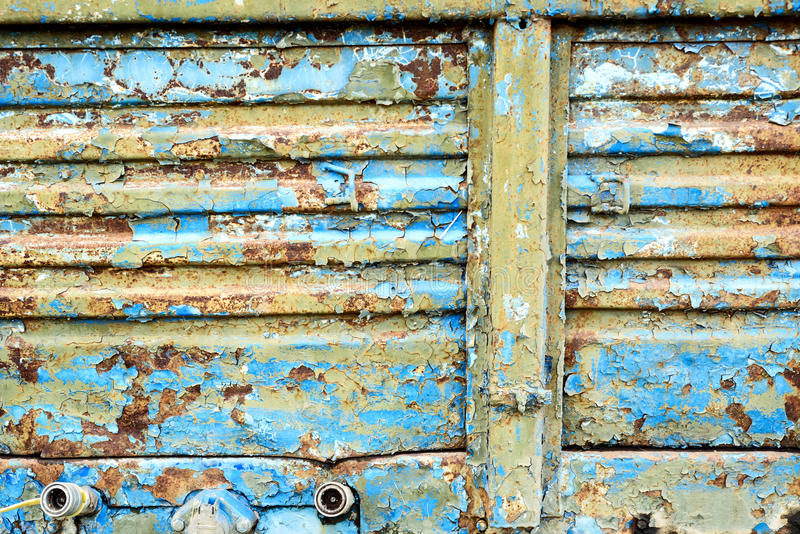 Blue Metal Rusty Sheet. Old corroded blue metal with rust flecks and peeling damaged paintwork royalty free stock photo
