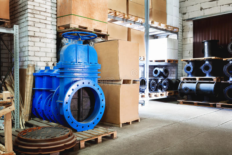 Blue metal shut-off valve for gas pipelines. Sliding knife gate valve Shutoff and control valves. boxes. fitting. Warehouse of pip. Modern locking devices allow stock photos