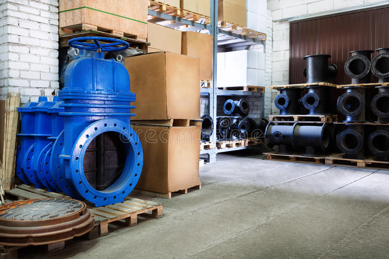 Blue metal shut-off valve for gas pipelines. Sliding knife gate valve Shutoff and control valves. boxes. fitting. Warehouse of pip. Modern locking devices allow royalty free stock photos