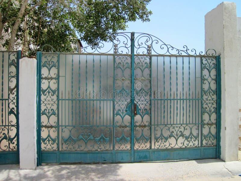 Blue metallic gate, Egypt. Beautiful blue metallic gate with ornaments in Hurghada town, Egypt stock image
