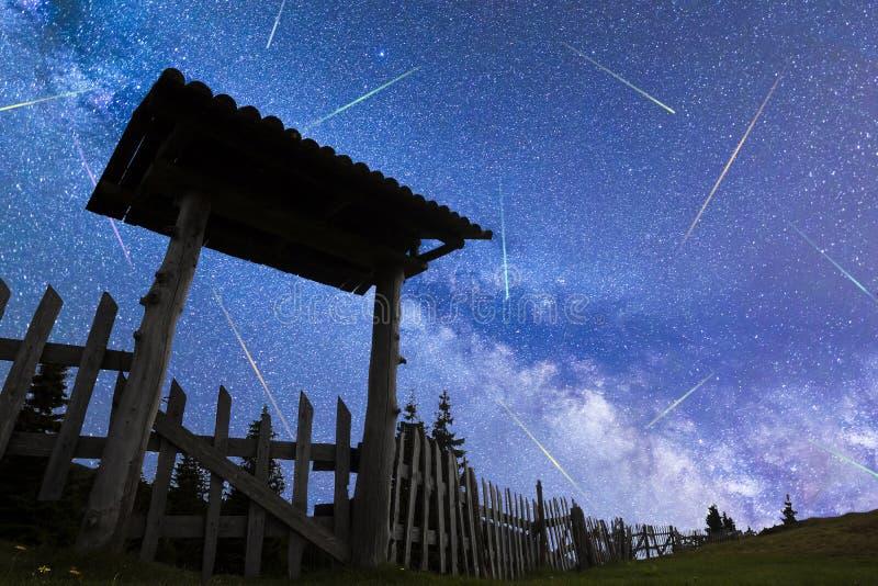 Blue Milky way falling stars entrance door fence stock photo