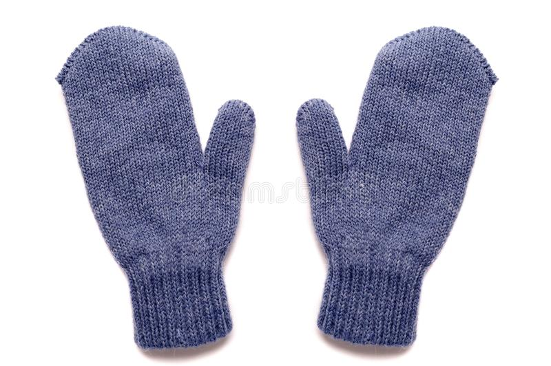 Blue mittens, isolated royalty free stock photos