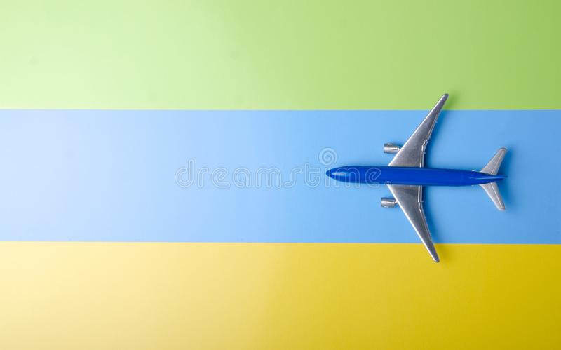 Blue model plane,airplane on color yellow blue green background stock image