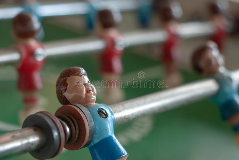 Blue model player on a foosball game stock photos