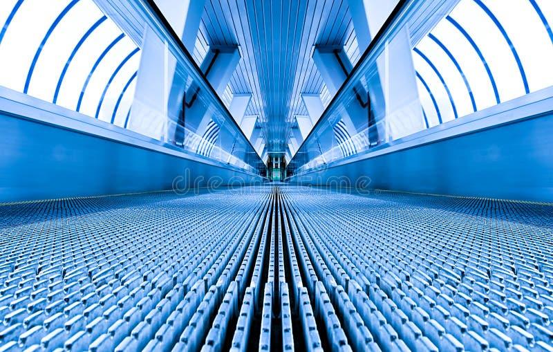 Blue modern escalator stock image