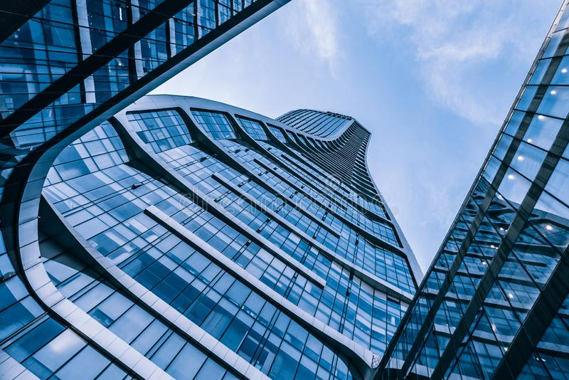 Blue Modern Glass Curtain Wall Architecture Low Angle Up-beat royalty free stock image