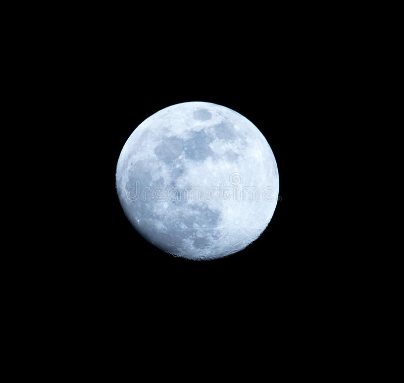 Blue moon on a black background at night.  royalty free stock photo
