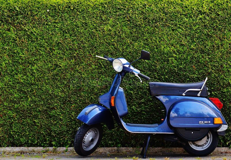 Blue Moped By Green Bush At Roadside Free Public Domain Cc0 Image