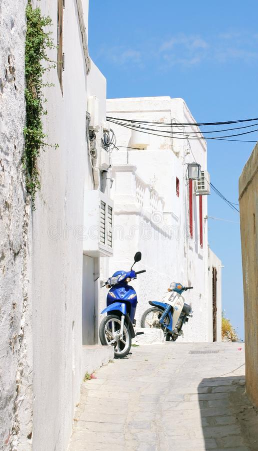 Blue mopeds on Narrow Street royalty free stock photos
