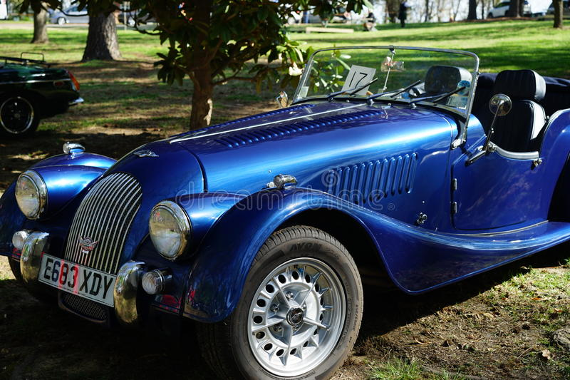 Blue Morgan roadster automobile. A classic Morgan car is an instant hit at a car show. The 6 cylinder engine and 6 speed manual transmission offers power and stock image