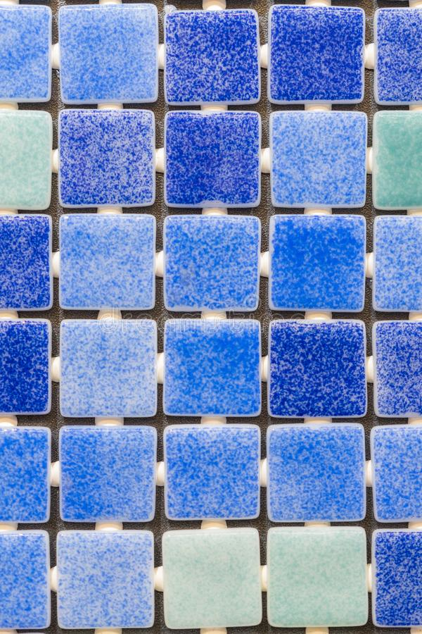 Blue mosaic tiles background. tile texture background of swimming pool tiles.  royalty free stock photography