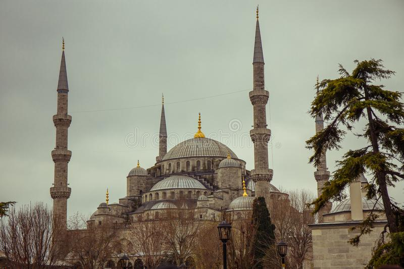 The Blue Mosque during the day. Tourists around the world are waiting ... Heavily cloudy sky to the evening. The Sultan Ahmed Mosque is the national mosque of stock photo