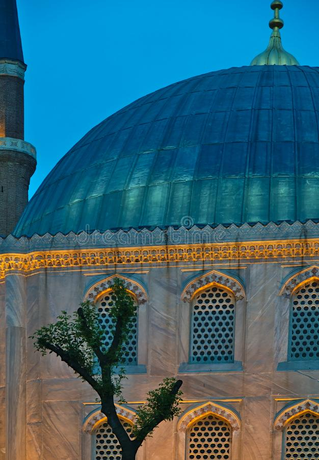 Blue mosque detail at night. Blue mosque detail, at night with artificial light and tree, Istanbul, Turkey stock image